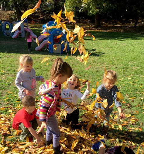 Berry Bright Students Playing in Leaves